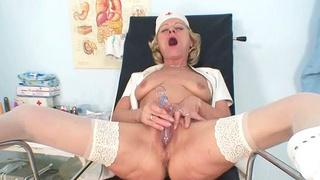 Blond granny nurse using gyno pussy spreader