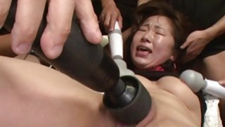 Jamming a sex toy all the way up her cunt