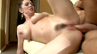 Hussy brunette Rayveness with her hairy pussy jumping on a cock and getting poked from behind