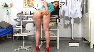 Blonde medical assistant spreading her muff wide