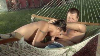 Brunette Kaylani Lei sucks a cock on the hammock