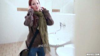 Kinky slut Belinda sucks a cock in the public toilet for money